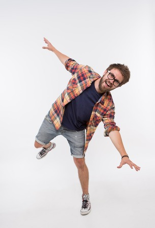 funny bearded man: Funny life moments of bearded man. Man in T-shirt, shirt and jeans shorts fooling in photostudio on white background. Stock Photo