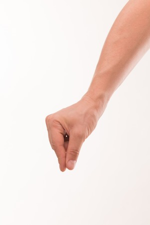 forcing: Close-up portrait of strong mans hand holding heavy object isolated on white background. Mans fingers forcing together.