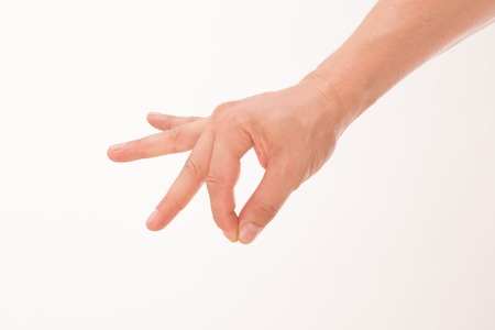 Caucasian mans hand like picking up something from the water isolated on white background. Point and thumb fingers are all together. Stock Photo