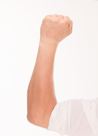 hand language: Left fist gesture concept. Close-up portrait of left males hand raised up with clenched fist isolated over white background. Stock Photo