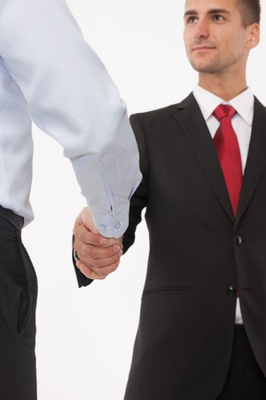 two companies: Two businessmen handshaking isolated on white background. Men having a deal between their companies or enterprises.