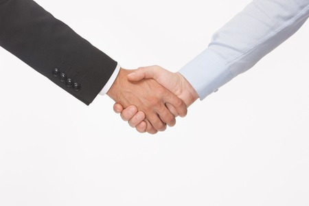 Two businessmen making agreement isolated on white. Bussines hand shaking will show succesful cooperation.