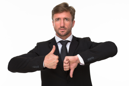 disapproval: Close-up of businessman hands giving a thumbs up and down gestures of disapproval and approval showing his negativity, dissatisfaction and positivity.