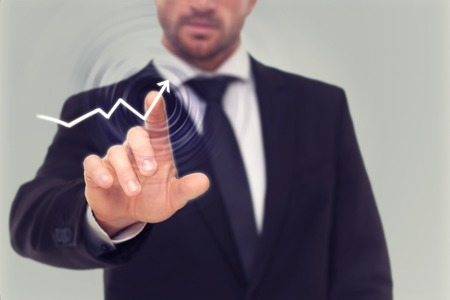 Close-up picture of businessman's finger drawing an activity diagram on the screen. Bearded man showing the growth of profit in the company. Stock Photo
