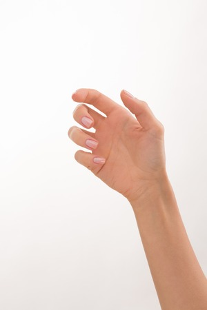 Woman's hand showing perfect manicare over white background. Woman hand and arm are nice idea for any advertisement.