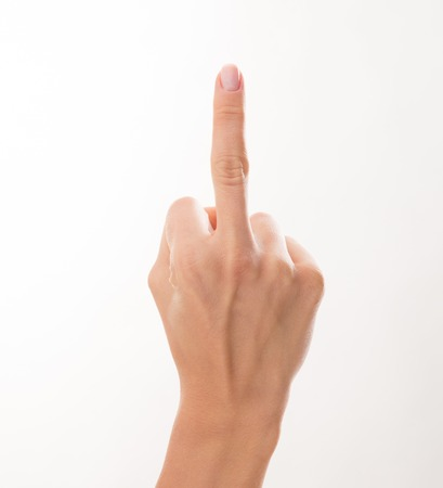 offend: Woman showing her anger with middle finger on her right hand. Woman is not satisfied by the situation happened.
