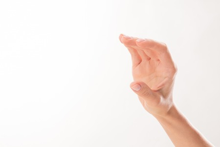 woman holding card: Womans hand represented in the way as if it is holding something over white background. It may be used for many purposes.