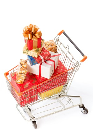 shopping cart isolated: Top view of New Year and Christmas presents or gifts represented in big shopping cart isolated on white background.
