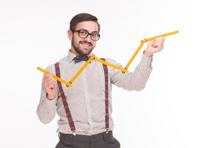 metre: Hipster business man holding metre and trying to measure something. Happy smiling man showing his business strategy.