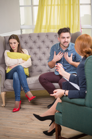 psychoanalysis: Couple visiting therapist for assistance. Couple making psychoanalysis at the psychotherapists office. Stock Photo