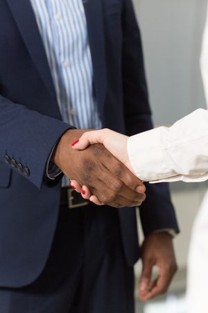firms: Business concept. Business people shaking hands showing mutual agreement betweent their companies of firms. Stock Photo
