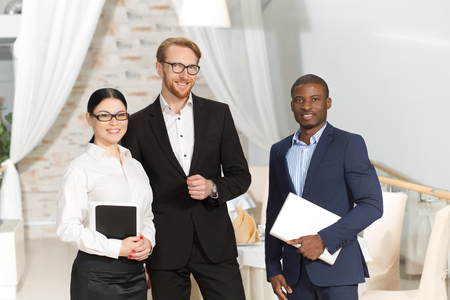 one on one meeting: Photo of two businessmen and one business woman having business meeting in restaurant. People discussing burning issues. Stock Photo
