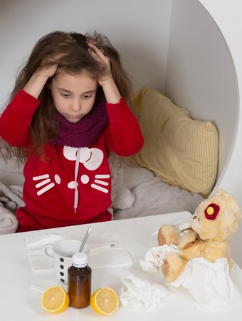 fed up: Fever, cold and flu concepts. Sick girl looking fed up with her illness. Gilr sittin on bed and combing her hair. Medicines.