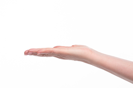 wanting: Open old womans hand, palm up isolated on white background. Female hand giving or wanting gesture.