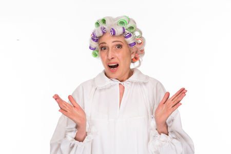 mouth opened: Surprised beautiful grandmother posing in studio with her mouth opened. Excited and astonished elderly lady in white clothing.