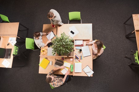 certain: Top view of business people having round tablein office. People working and discussion certain business projects. Business and freelance concepts. Stock Photo