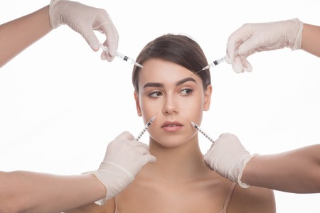 revitalization: Cosmetic injection in the spa salon. Beautician makes injection into patients face. Beauty injections, mesotherapy, revitalization, cosmetic medicine injection. Concept of rejuvenation.