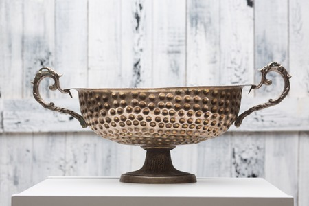 singing bowl: Accessories for sound massage. Tibetan singing bowl treatment. Bronze ancient cauldron isolated over white background.