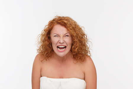 one senior woman only: Mature Caucasian woman yelling with angry expression.