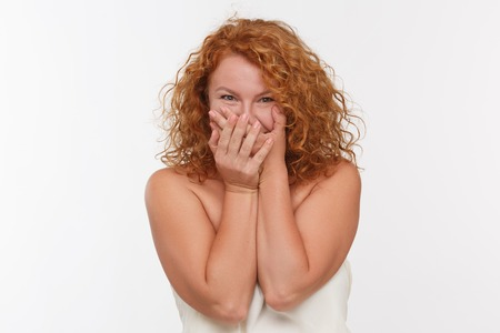 shoked: Portrait of shocked mature woman isolated on white background.