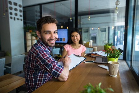 restaurant questions: Beautiful lady having interview in restaurant or cafe. Handsome man asking business questions during interview.