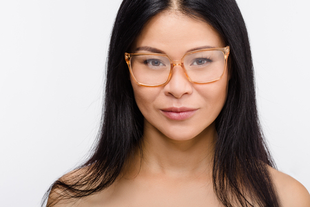 beleza: Closeup picture of beautiful Korean or Asian woman in glasses isolated on white background in studio. Beauty, vision concepts. Imagens