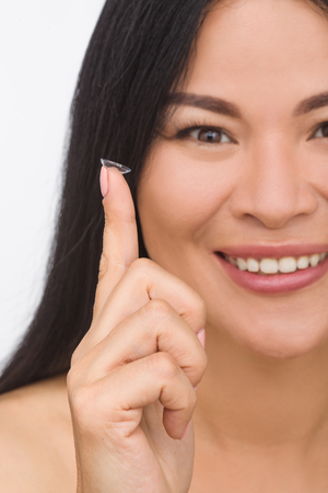 Beauty, vision, eyesight, ophthalmology and people concepts. Young Korean woman with contact lenses. Stock Photo