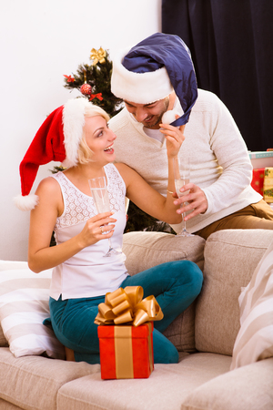 chrstmas: Picture of beautiful happy Christmas couple celebrating New Year at home atmosphere. Cheerful man and woman spending free time all together. New Year or Chrstmas concept.
