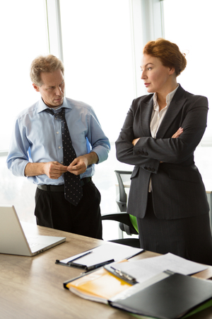 colloquium: Two angry bosses man and woman in office Stock Photo