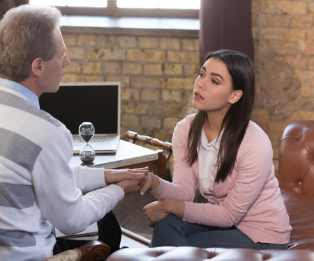 psychologists: Young woman at psychologists office Stock Photo