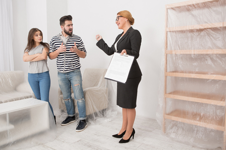 Real estate scammers with an estate agent. Stock Photo
