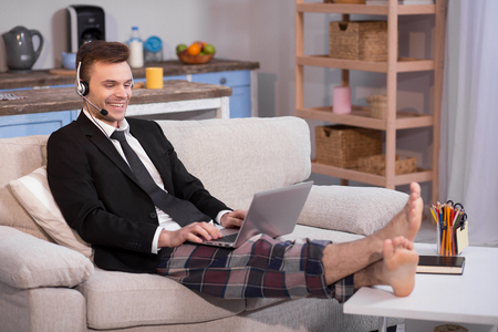 homeoffice: Close up view of a man working on freelance at home. Stock Photo