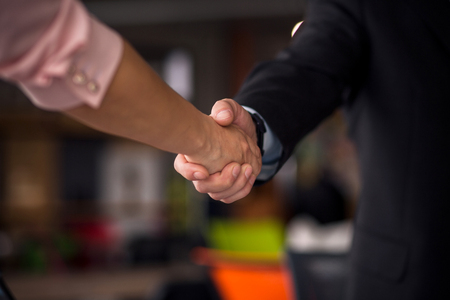 Close up view of business partners shaking hands. Stock Photo