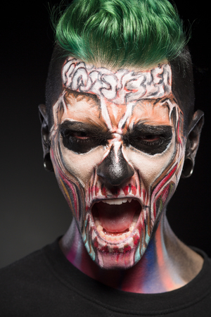 close up eyes: Detailed portrait of bright skull makeup for Halloween. Mystical face art on mans face.