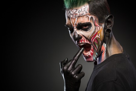 close up eyes: Scary zombie makeup on mans face isolated on black background. Face art, man with monster face.