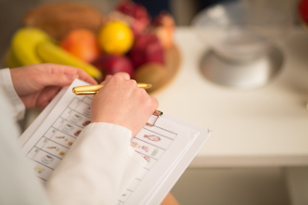 Close up image of note book and pen of dietitian. Healthy life style concept. Stock Photo