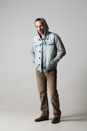 Image of a handsome man with a jacket standing on white background. 版權商用圖片