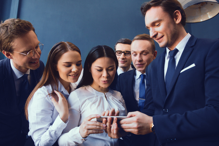 Business People In Formal Clothes Looking At Selfie They Did In Office After Presentation. Business Concept. Reklamní fotografie