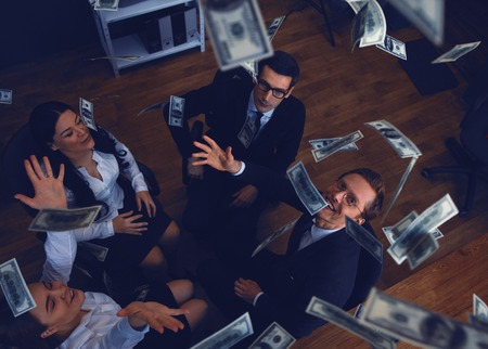 Business Team Throwing Money After Making Great Project. Having Celebration. Business Concept. Stock Photo