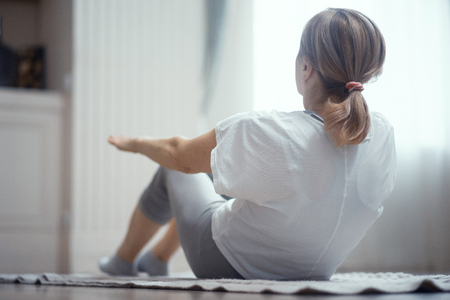 Back Of Mature Woman Practicing Yoga. Woman At Pilates Working Out. Selective Shot. Back View