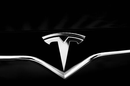 Big Tesla Logo Close-up. Metal t Letter Symbol of Tesla Car. Emblem Represents Cross-Section of Electric Motor. Kyiv, Ukraine, F-Drive showroom 13 of february 2018. Sajtókép