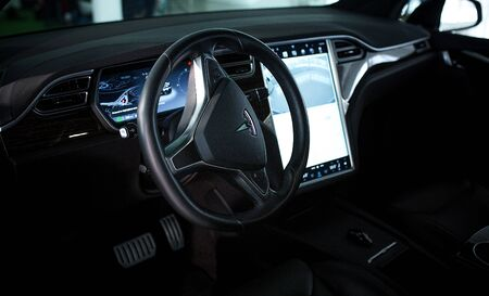 Tesla Luxury Automobile Inside View. High Technologies in New Generation Modern Electric Vehicle. Control Displays and Navigator Inside Tesla. Kyiv, Ukraine, F-Drive showroom 13 of february 2018.