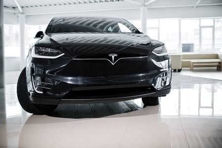 Powerful Enviroment-Friendly Tesla Automobile in Auto Show. Premium Segment Electric Vehicle Standing Indoor. New Tesla Model by Elon Musk.Kyiv, Ukraine, F-Drive showroom 13 of february 2018.