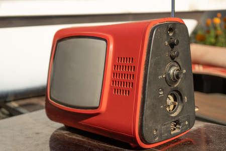 Retro Old Plastic TV Set Reciever On Wooden Table Ar Rhe Garage Sale