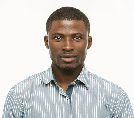 Attractive Dark-skinned guy looks confident. African american serious man isolated on white background. Toned image. Stock Photo