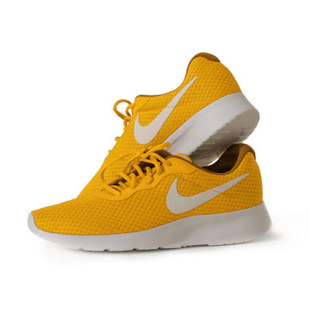 Yellow sneakers of Nike brand. Sport unisex model for running. Shoes on white background. Lifestyle concept. May, 2019. Kiev, Ukraine. Editorial