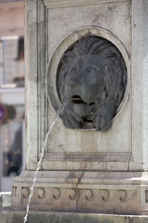 Josephs fountain. Bas-relief in the form of a lions head with running water. April, 2013. Vienna, Austria. Éditoriale