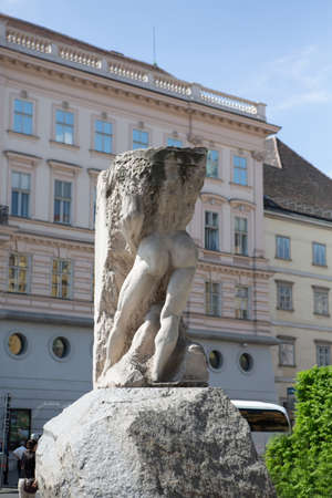Sculpture called Orpheus entering hell or Stone of republics. Against on architecture in central square. April, 2013. Vienna, Austria. 新闻类图片