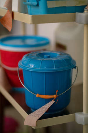 Plastic buckets with label in medical office. Storage containers for medical supplies. Close up shot. City Hospital. May, 2020, Brovary, Ukraine.