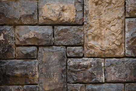 Old brick or stone wall. Antique brown wall different size brick masonry. Vintage texture or background.